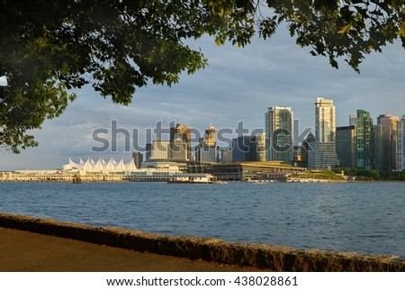 Vancouver Skyline from Stanley Park. Downtown Vancouver seen from Stanley Park at sundown. Vancouver, British Columbia, Canada.                             - stock photo