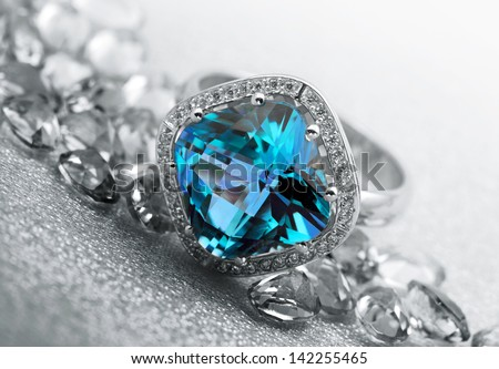 Various Jewelry gem stones on grey background - stock photo