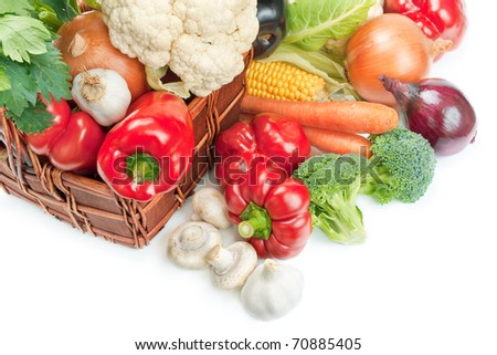 Vegetables. Mix of fresh ripe vegetables arranged in a wicker basket and around isolated on white background - stock photo