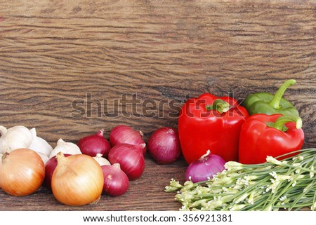 Vegetables on wooden table.