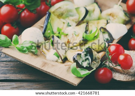 Vegetarian Eggplant rolls with cottage cheese, selective focus and toned image - stock photo