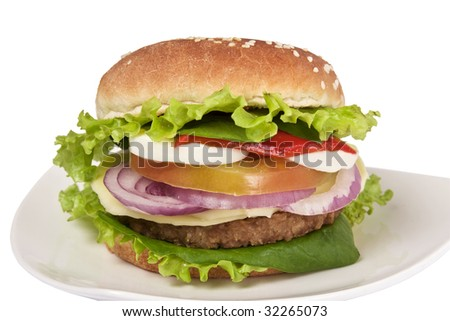 Veggie burguer containing: soy meat, cheese, lettuce, tomato, cucumber, onion, egg. It has a clipping path. - stock photo