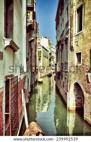 Venice canal  at sunrise. Tourists from all the world enjoy the historical city of Venezia in Italy, famous UNESCO World Heritage Site. Filtered image, vintage affect applied