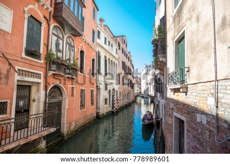 Venice, Italy - 21 May 2017 : View of Gondola with building along the canal in Venice.
