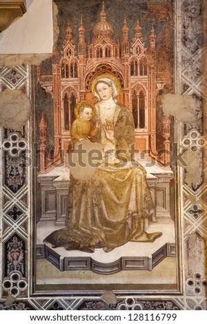 "VERONA - JANUARY 28: Fresco of Holy Mary ""Madonna delle Grazie"" by Turone circa 1360 in church Santa Maria della Scala in on January 27, 2013 in Verona, Italy. - stock photo"