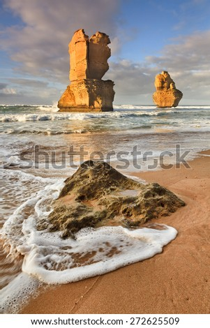 2 vertical remote sandstone columns - part of 12 apostles landmark on Great Ocean Road national natural park in Australia on sunny summer day from beach sand - stock photo