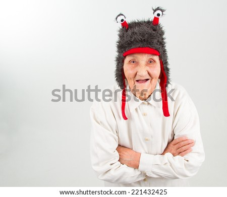 very old lady in funny fur hat with two tentacles  - stock photo