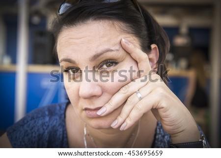 Very sad mature woman.  - stock photo