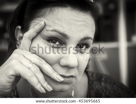 Very sad mature woman. Black and white photo - stock photo