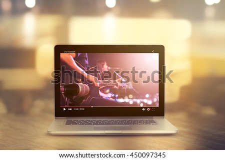 Video player of live concert guitarist on stage, all on laptop screen are design up - stock photo