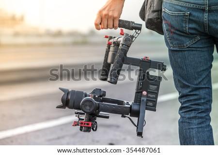 videographer with gimball video slr - stock photo