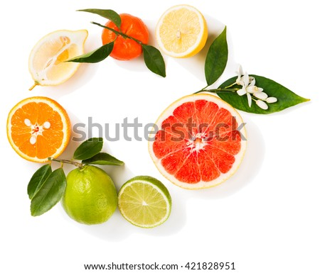 View from above of citrus fruit ( lime, lemon, orange, grapefruit and tangerine) with leaves and flowers isolated on white background. - stock photo