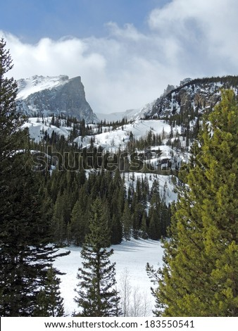 view of hallett peak in winter from bear lake, in rocky mountain national park,  colorado     - stock photo