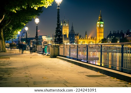 View of London England skyline including Big Ben and Westminster seen at night.  - stock photo