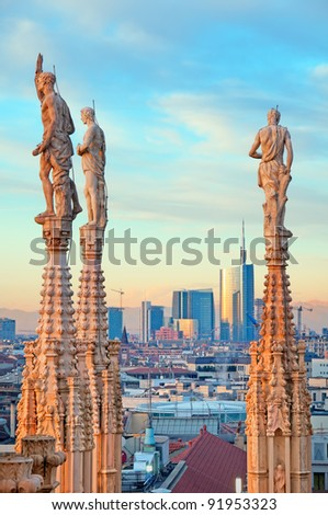 View of Milan's financial district and statues of Duomo of Milan. - stock photo