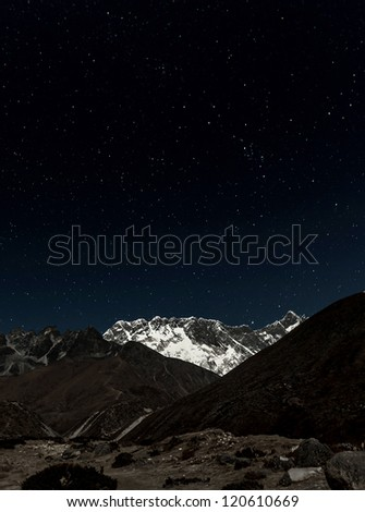 View of Mt. Everest in the Moonlight - Nepal, Himalayas - stock photo