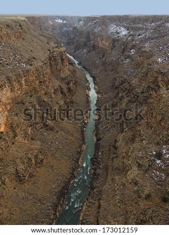 view of rio grande from rio grande gorge bridge,  near taos, new mexico           - stock photo