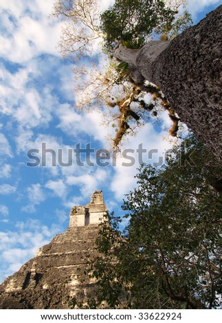 View of the ancient Mayan pyramid, Temple of the Jaguar. This is one of the pyramids in the central acropolis at Tikal. Tikal National Park, El Peten, Guatemala, Central America. - stock photo
