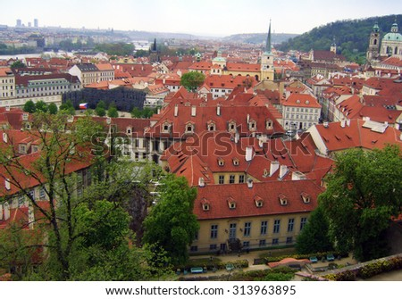 View of the rooftops of the old and well-preserved city of Prague. - stock photo