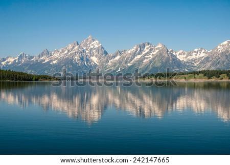 View of the  Teton Range from the  Jackson Lake,  Grand Teton National Park - stock photo