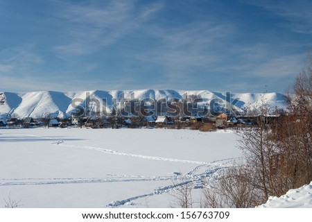 Views of the beautiful hilly bank of the river in winter. Russia, Tatarstan, the Kama River, Lower Kama region.