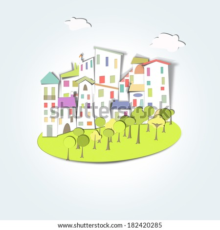village of field, surrounded by green forest and nature, and houses with colored roofs - stock photo