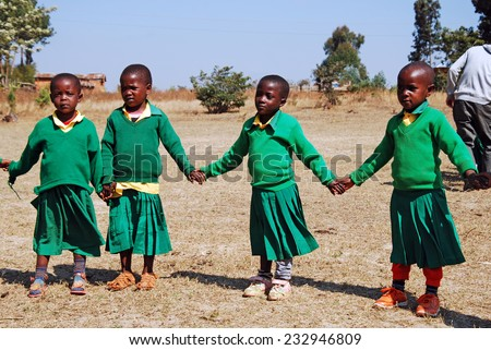 """4-08-2014""-""Village of Pomerini""-Tanzania-Africa - The game of kindergarten children built in the Franciscan Mission of the Village of Pomerini-Many of these children are suffering from AIDS.  - stock photo"