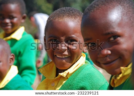 """""""4-08-2014""""-""""Village of Pomerini""""-Tanzania-Africa - The game of unidentified kindergarten children built in the Franciscan Mission of the Village of Pomerini-Many of these children are suffering from AIDS.  - stock photo"""