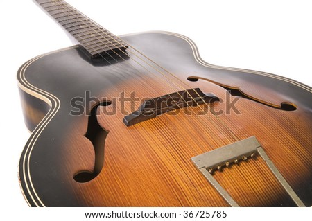 vintage acoustic guitar, white iso. - stock photo