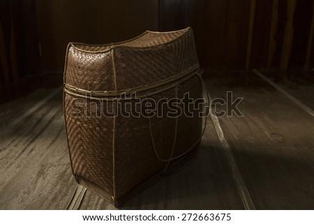 vintage  bamboo bag  on brown wood desk background - stock photo