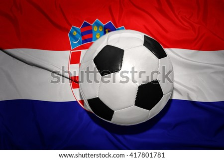 vintage black and white football ball on the national flag of croatia - stock photo
