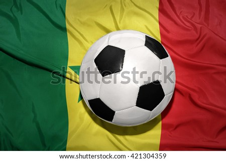 vintage black and white football ball on the national flag of senegal