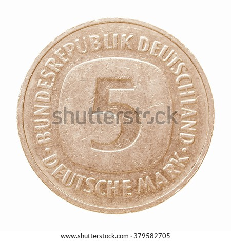 Vintage German coin isolated over a white background vintage