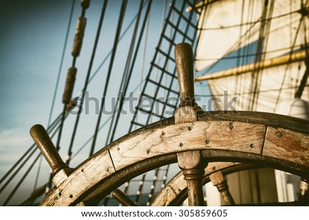 Vintage Helm. Toned image and blur. Retro style postcard. Tall Ship. Yachting.  Sailing  - stock photo