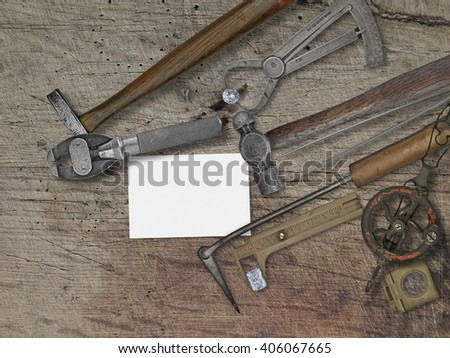 vintage jeweler tools and diamonds over wooden bench, space for your business name - stock photo