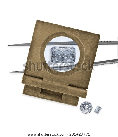 vintage loupe over diamond and tweezers, two diamonds on side - stock photo