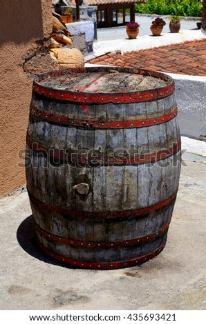 Vintage old wooden wine barrel in a vinery of Tenerife,Canary Islands,Spain. - stock photo