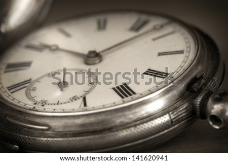 Vintage pocket watch in closeup. - stock photo