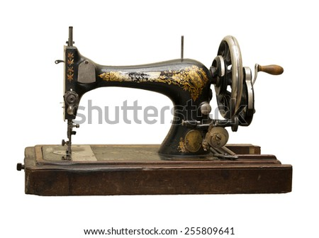 Vintage sewing-machine-is isolated on the white - stock photo