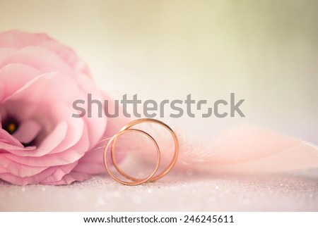 Vintage Wedding  Background with gold Rings and beautiful Eustoma rose flower - stock photo