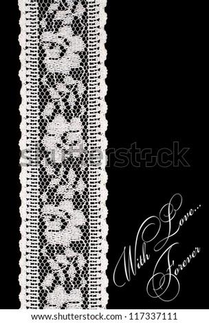 vintage white lace on a black background - stock photo