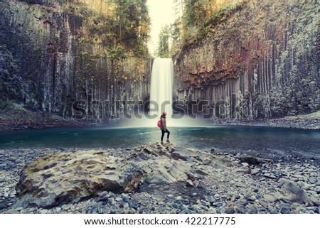 (Vintage) woman on the rock at Abiqua Falls, Oregon. Abiqua Falls is one of the hidden gems in Oregon. Oregon also has many unrecognized falls.  Oregon also has the landscape of old volcanic rocks - stock photo