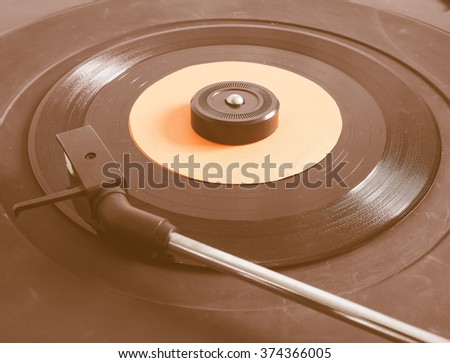 Vinyl record on a turntable record player, single 45rpm disc vintage - stock photo
