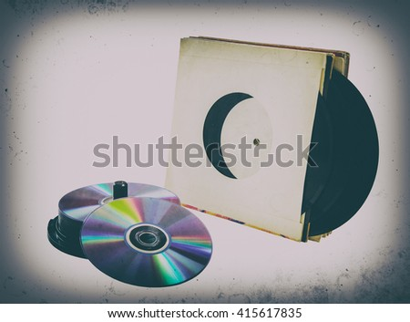 vinyl records and cd CD-R, DVD on a white background. isolated; retro style, vintage, old photo - stock photo