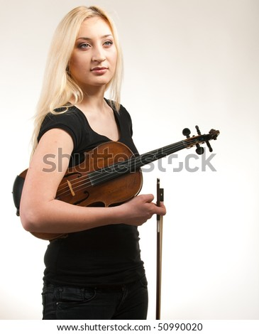 Violin player posing on green  background