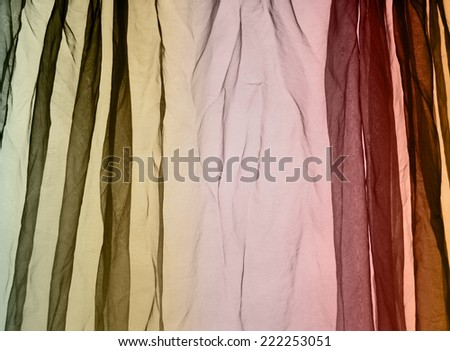 Voile curtain fading colors green to red to orange background    - stock photo