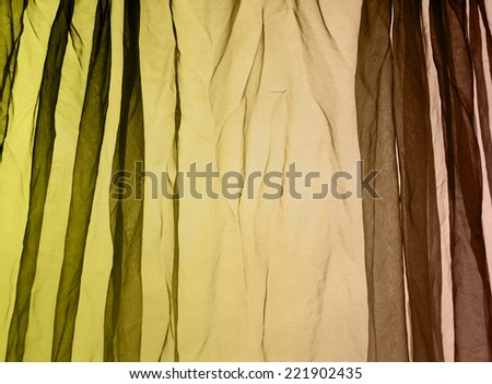 Voile curtain fading colors green to yellow to brown background   - stock photo