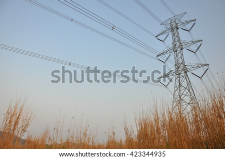 500,000 volts transmission latice tower with double suspension insulator strings. - stock photo