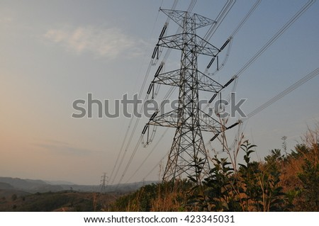 500,000 volts transmission line cross over the hill. - stock photo