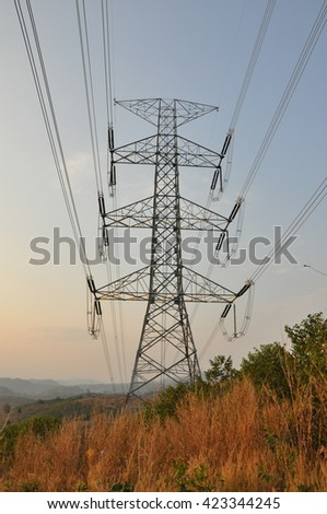 500,000 volts transmission tension tower located on mountain. - stock photo